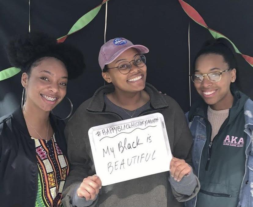 BSA alumni Shanelle Wilkins, Kamryn Calhoun and Geonnie Wilson smile in the photo booth at the end of Black History Month in February 2019 after their talent show event. Students were able to sing, read poetry, play instruments and more.