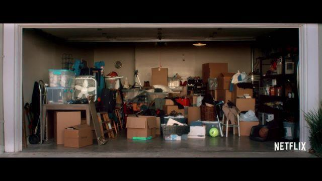 An average American garage is shown while Millburn explains it is the most cluttered part of a house. Millburn continued to build his point by listing out all possible categories of items in each box.