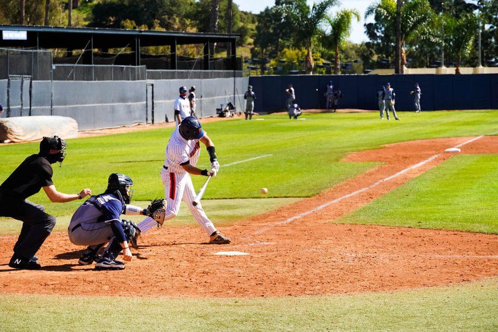 Senior catcher Joe Caparis swings low in game two against CBU. Caparis had a .164 batting average last season and has yet to secure his first hit.