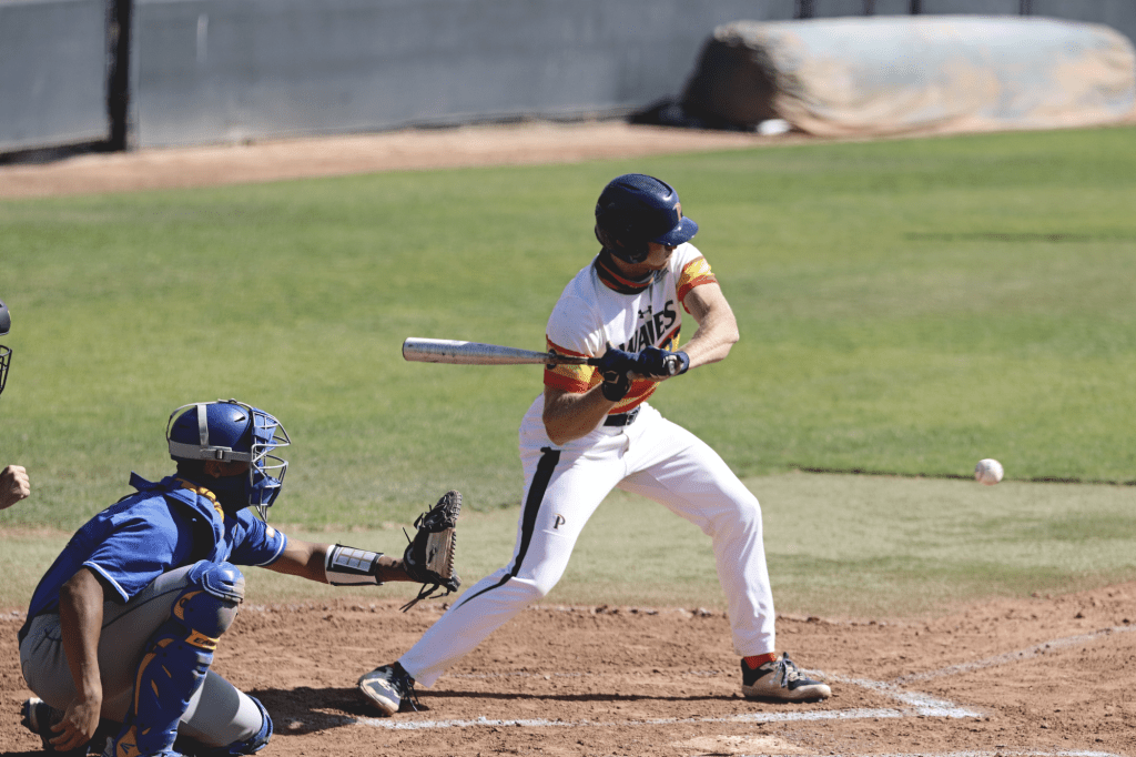 Senior outfielder Billy Cook swings at a first-inning pitch during Sunday's game. On Saturday, Cook's first hit of the season was a grand slam that briefly gave Pepperdine the lead.