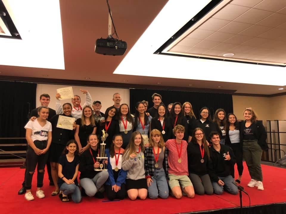 Hernandez celebrates with her high school debate team after a successful competition in Honolulu in February 2020. Hernandez said the debate team helped her discover her passion for politics.
