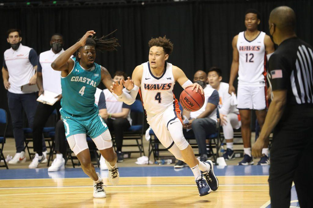 Senior point guard Colbey Ross dribbles the baseline during the CBI championship game versus CCU on March 24. In his final game as a Wave, Ross finished with 15 points and 7 assists.