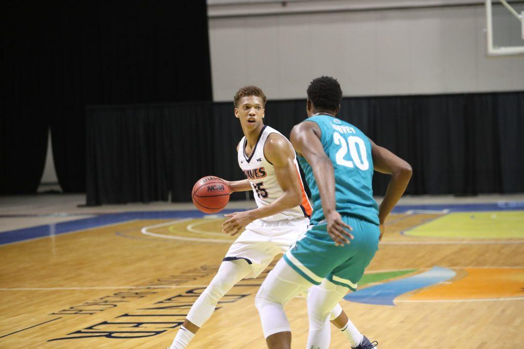 Junior forward Kessler Edwards scans the floor during the CBI championship game versus CCU on March 24. Edwards received MVP honors and averaged nearly 20 points and 3 blocks per game in the tournament.