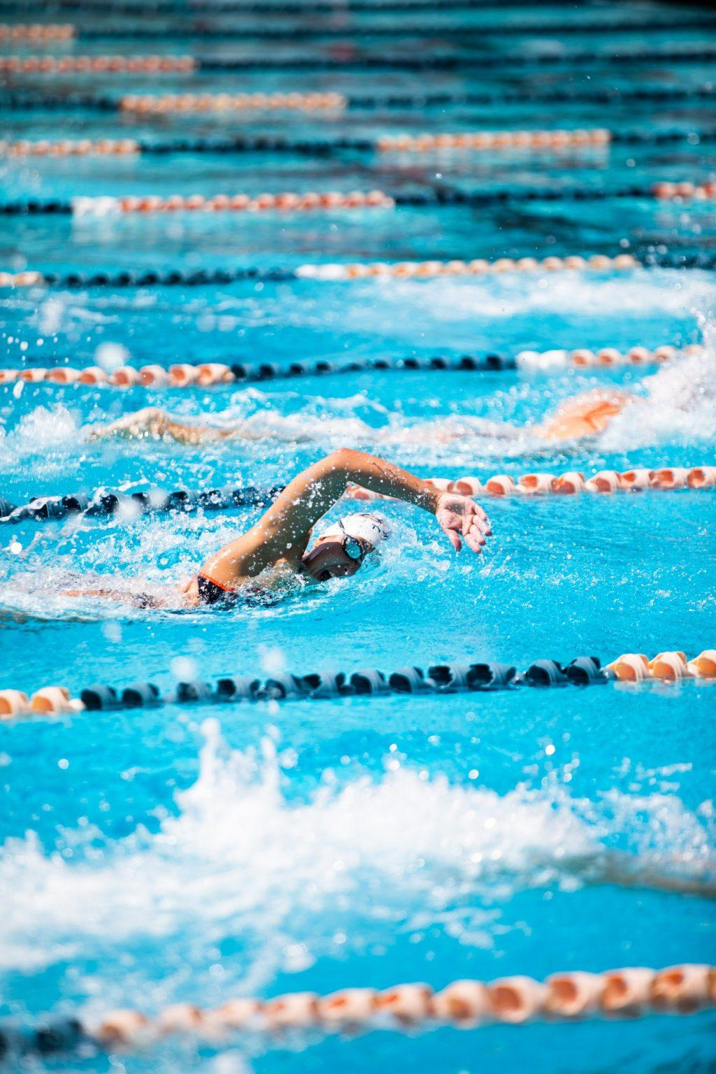 Junior Audrey Camarillo tilts her head to breathe during the 50-yard freestyle against Biola. Camarillo placed third in the event and also swam a 54-second 100-yard freestyle.