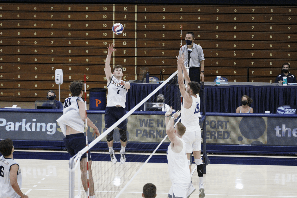 Senior outside Spencer Wickens tips the ball to score a point during the third set against GCU on March 28. Wickens was a top scorer with 14 kills for the Waves against GCU in three matches.
