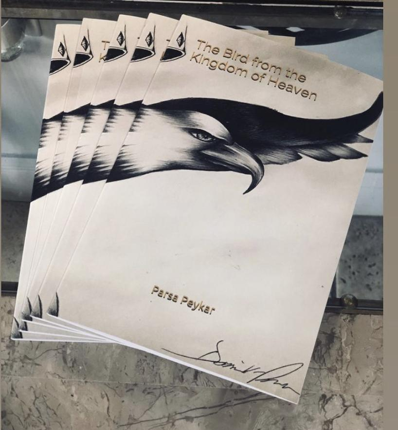 "English copies of ""The Bird From the Kingdom of Heaven,"" splay across a table in October 2018. Peykar said the book is about a caged bird that finds freedom."