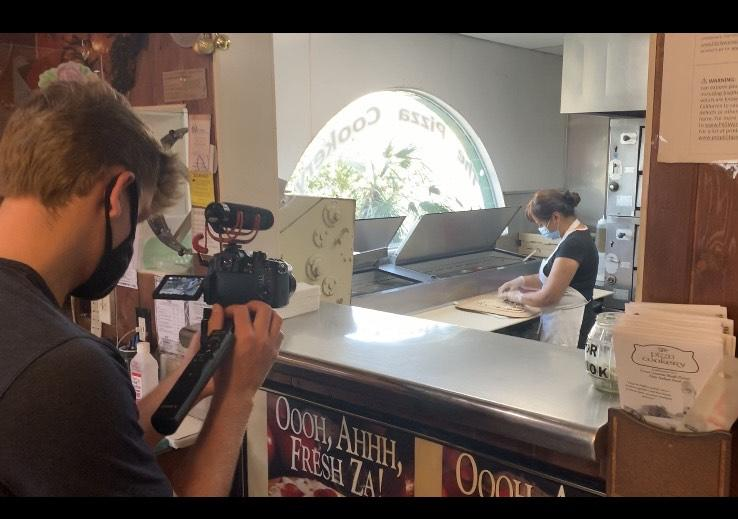 Ladas films a glimpse behind the scenes for their restaurant profile on The Pizza Cookery in August in Encino, Calif. Djalilov said the 40-year-old restaurant was the first they profiled.