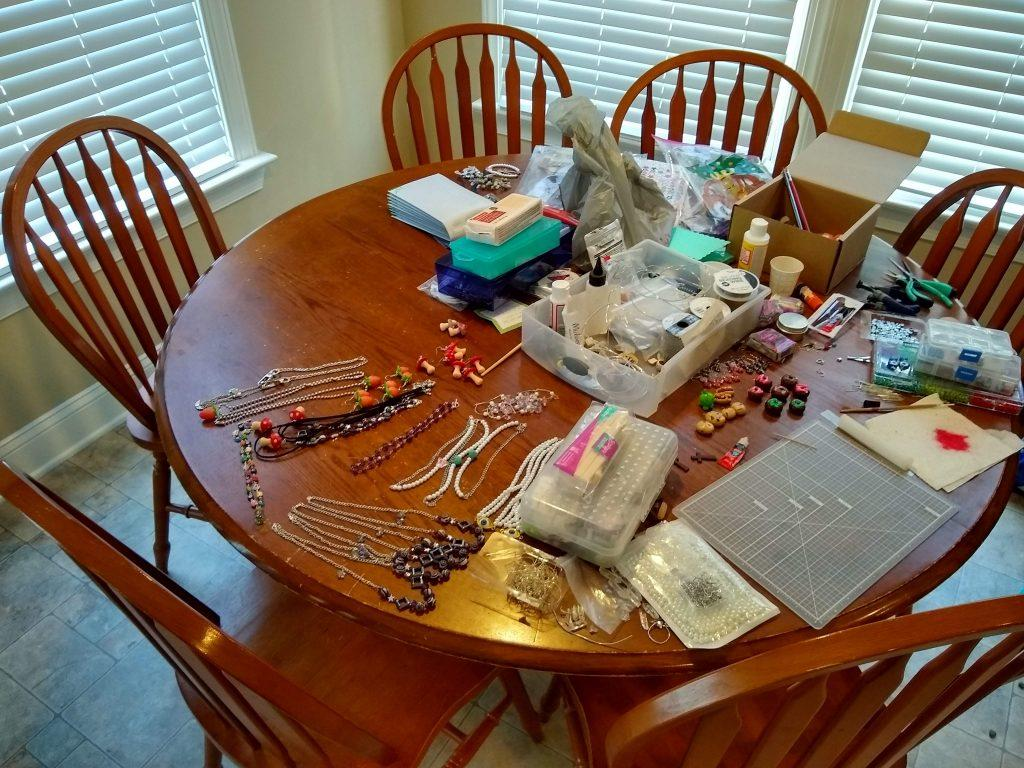 Hardwick's jewelry-making supplies take up most of the space on her kitchen table in her home. Hardwick said she makes and packages all of her jewelry orders here.