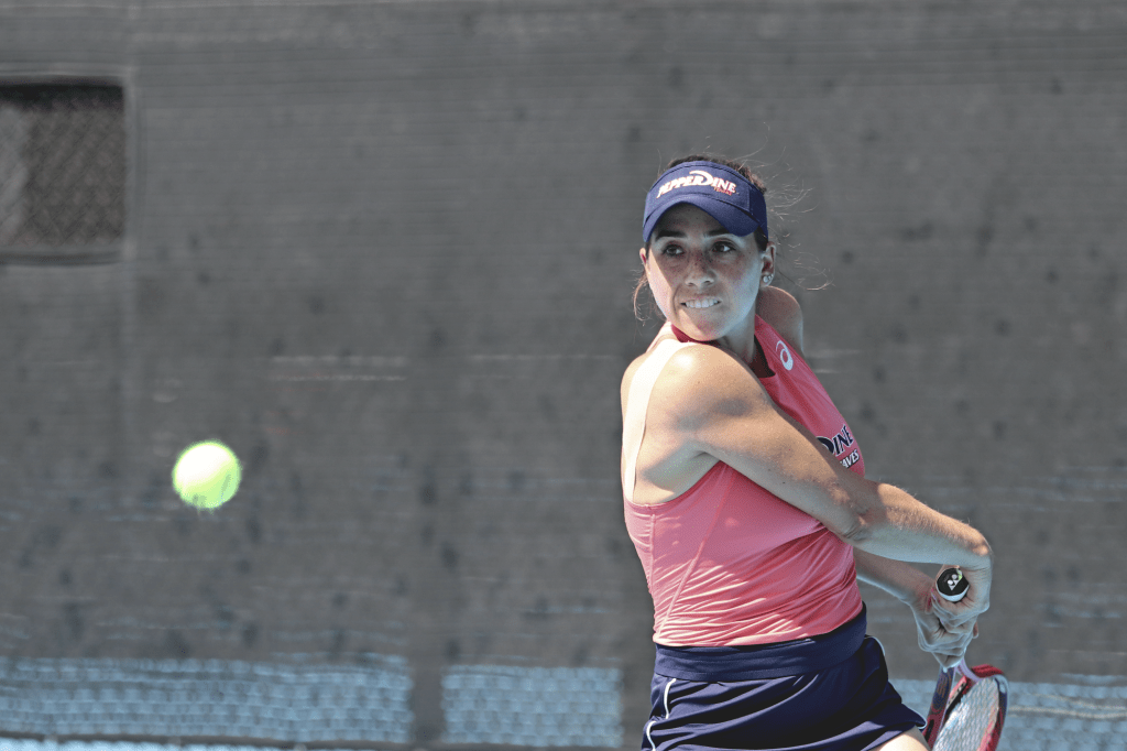Redshirt Freshman Lexi Ryngler winds up for a hit in her doubles match March 25. Ryngler and partner Olsen won their doubles match 6-2.