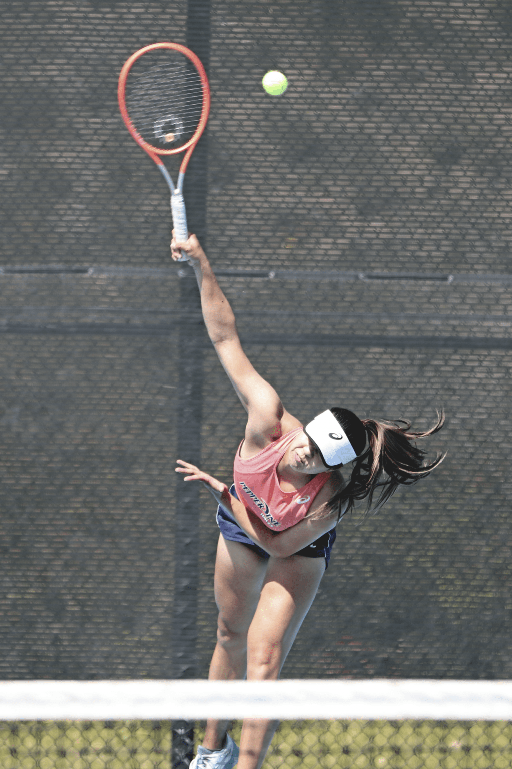 Graduate student Shiori Fukuda serves in her singles match against the Broncos on March 25. Fukuda's victory in singles gave the Waves the sweep.