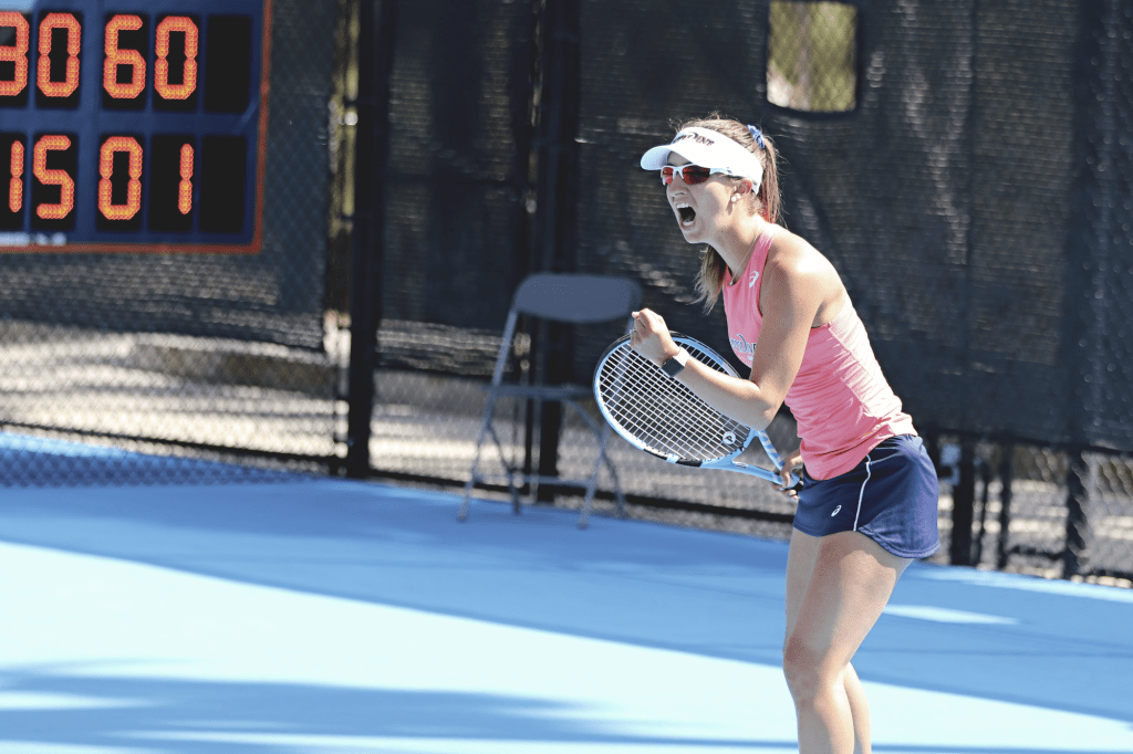Graduate student Jessica Failla celebrates a point in her singles match against Jenna Marie Gordon. Failla only dropped one game during her singles match against the Broncos.