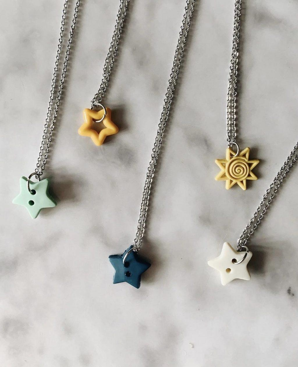 Tyler's newest necklaces include star and sun repurposed button charms, featured on her Etsy since December. Tyler said many Pepperdine students and friends have supported her business, and she is excited to watch it blossom.