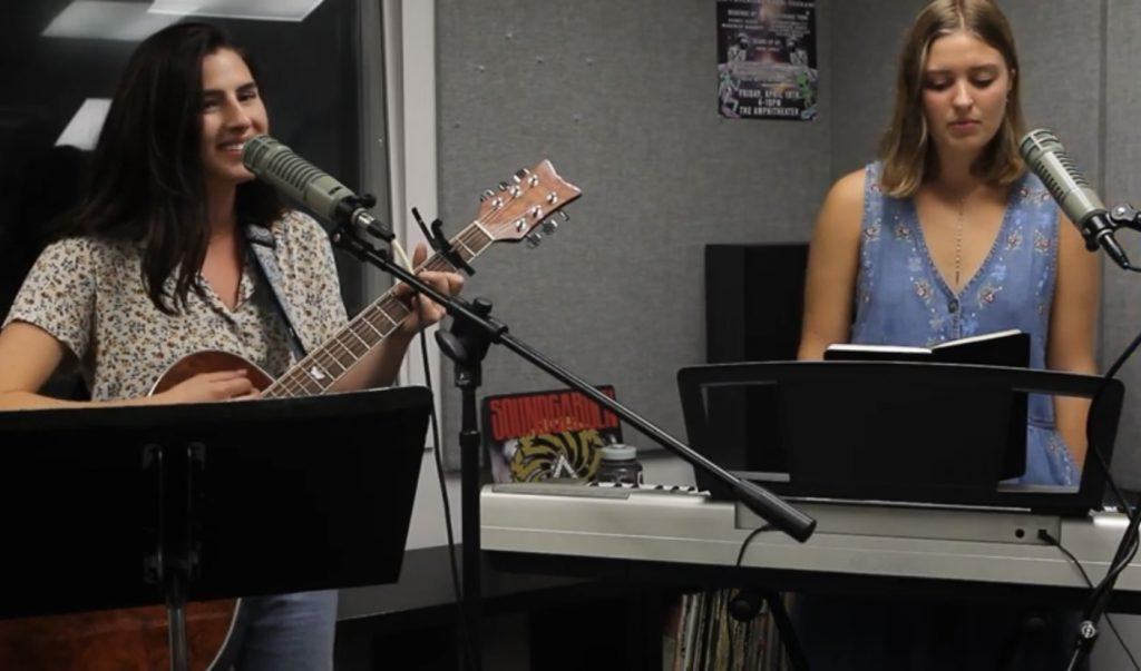 """Sullivan (left) and Davis (right) perform their original song """"Inner Space"""" for PGM&squot;s podcast Small Studio Sessions in September 2019. When Davis and Sullivan were abroad in Lausanne, Switzerland, they fostered a music community and had a room of instruments where they loved to practice. Photo courtesy of Small Studio Sessions"""