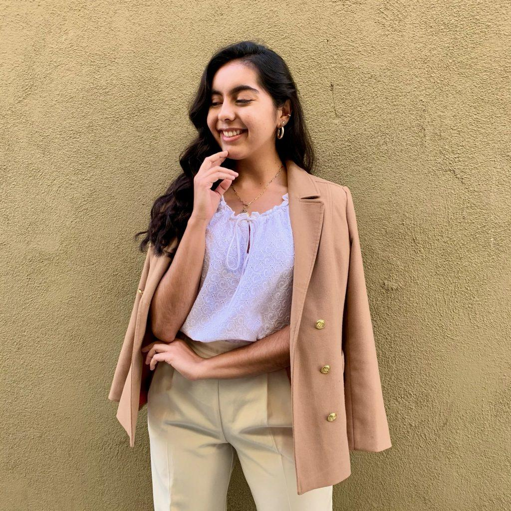Chavez models hand-picked pieces in Long Beach, Calif., in January to sell on her second-hand Instagram shop, @thrift.w.maria. Chavez created this shop to celebrate and promote sustainable fashion. Photo courtesy of Maria Chavez