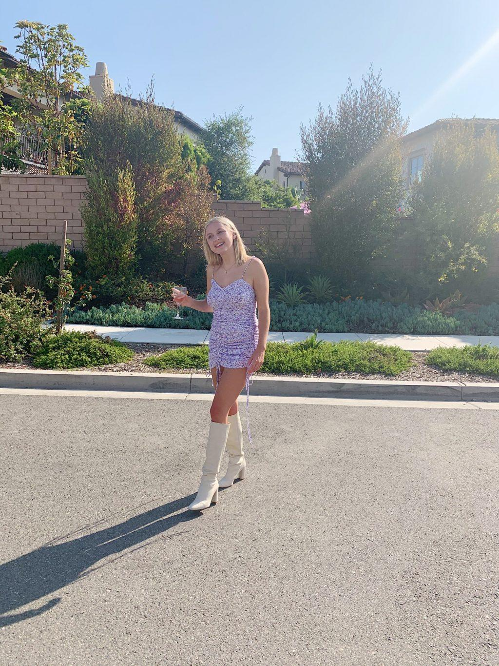 Senior Taylor Launius poses in a floral dress and knee-high white boots at a friend's birthday in San Clemente, Calif., in July. Launius said she loves wearing bright colors during the spring. Photo courtesy of Taylor Launius