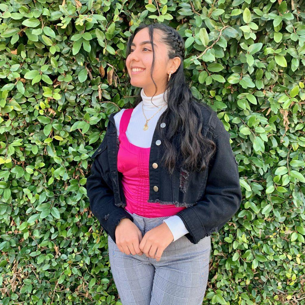 Junior Maria Chavez matches a bright pink tank top with a white turtleneck in January in Long Beach, Calif., for this fashionable look. Chavez said she loves experimenting with different styles and colors during the spring. Photo courtesy of Maria Chavez