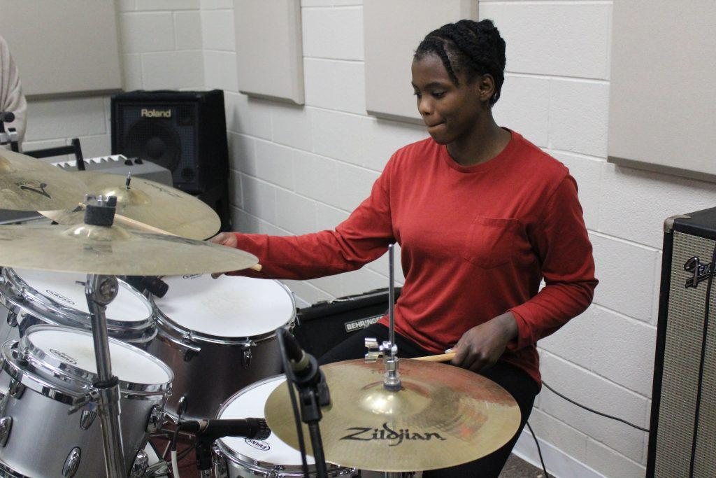 "Ferrari plays the drums in the music room at her high school in Birmingham, Ala., in January 2019. About a year later, Ferrari said she released her first single on Spotify called ""Don&squot;t Let It Fall Don&squot;t Let It Break."""