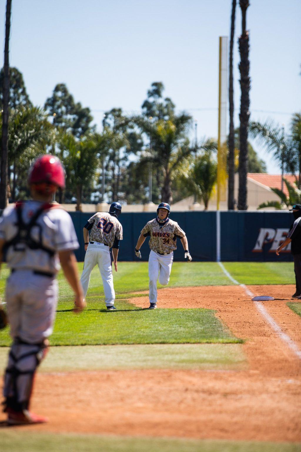 Pepperdine senior first baseman Justin Lutes rounds third after blasting a 375-foot home run to right field Saturday in Malibu. Lutes' homer put the Waves ahead 2-1 en route to a series-clinching 7-2 win.