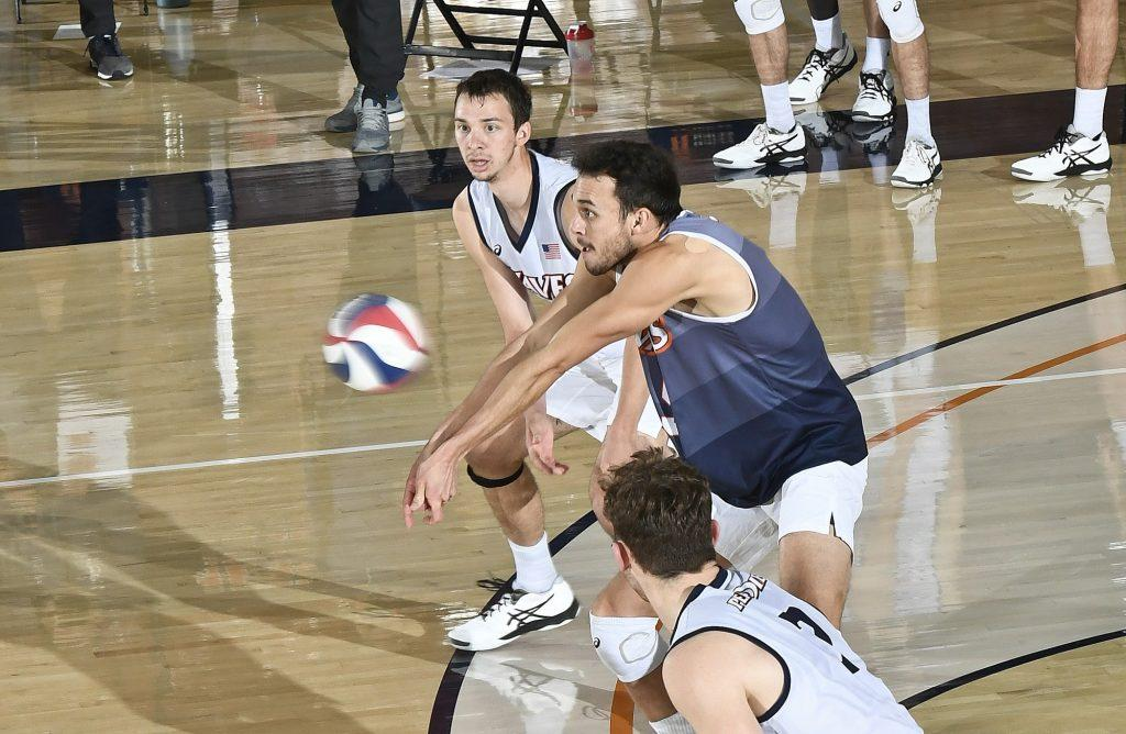 Redshirt senior Noah Dyer passes a BYU serve during Friday's match as senior teammates Alex Gettinger (background) and Spencer Wickens (foreground) look on. The Waves conceded 10 service aces in Friday's loss but only 2 in Saturday's loss. Photo Courtesy of Martin A. Folb | Pepperdine Athletics