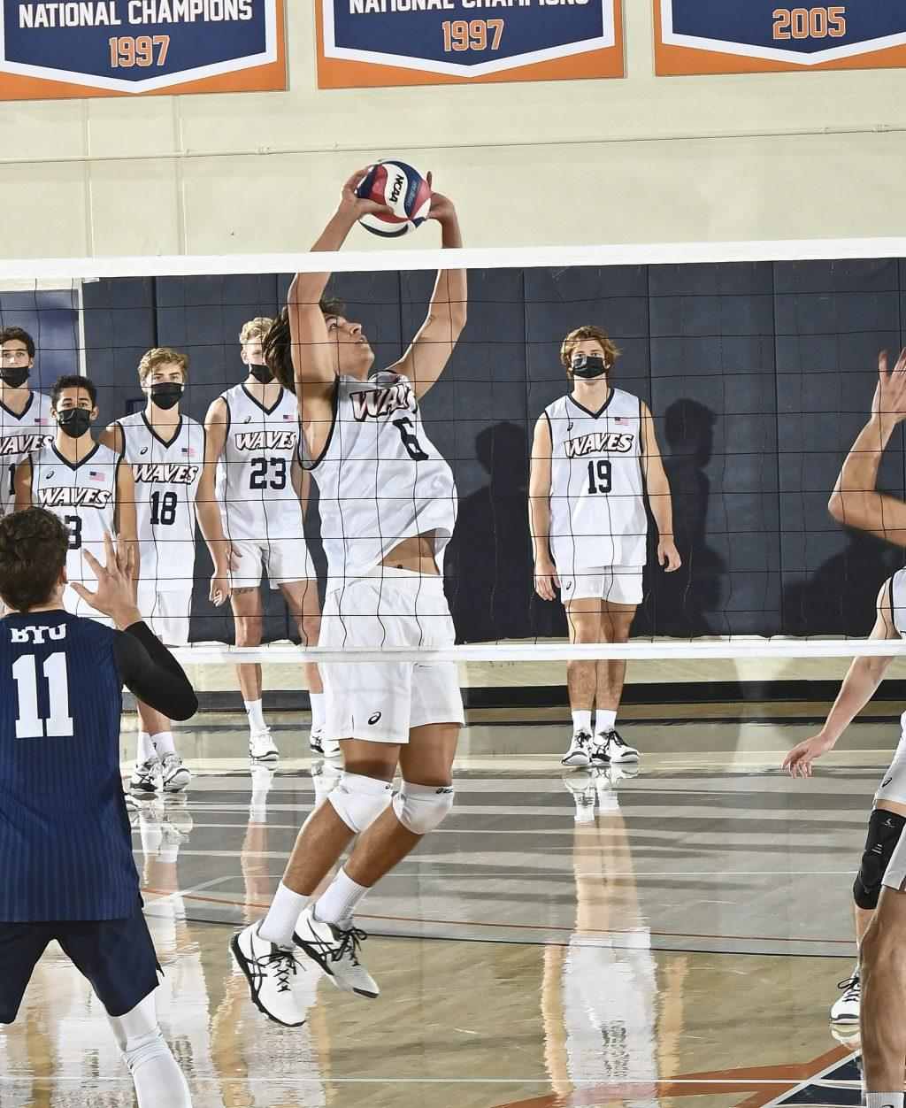 Freshman setter Bryce Dvorak delivers a set to a Waves teammate Friday. Dvorak finished with 33 assists and 6 digs in a four-set loss. Photo courtesy of Martin A. Folb | Pepperdine Athletics