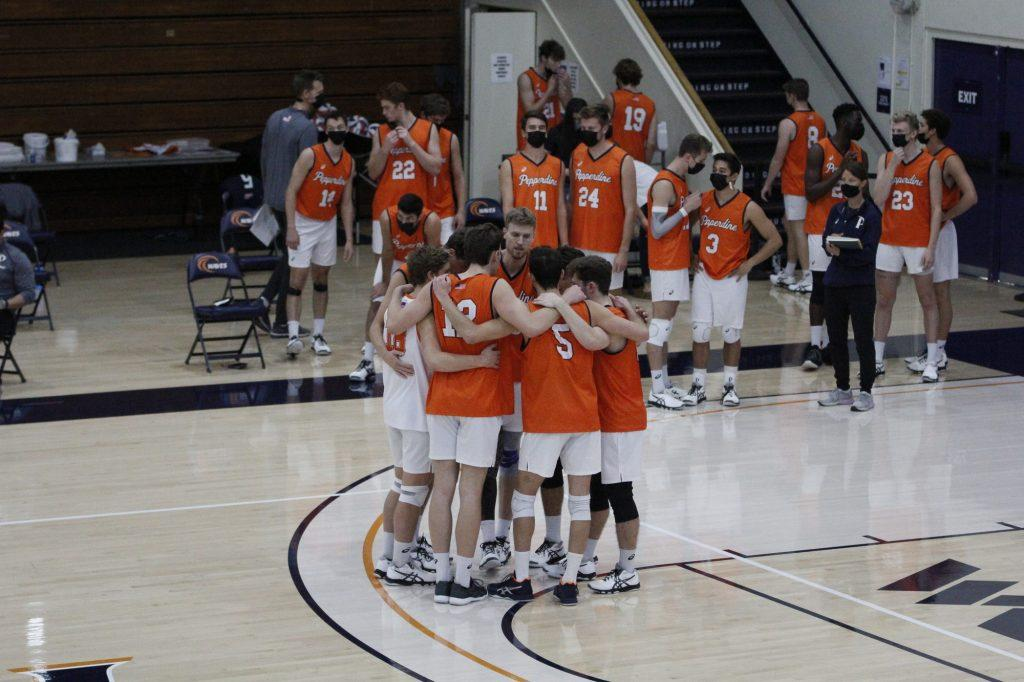 Pepperdine Men's Volleyball huddles to regroup after losing the first set to BYU on Saturday at Firestone Fieldhouse. The team fell in two matches against the Cougars on March 19 and 20, and will now prepare for three weekend matches against Grand Canyon University.