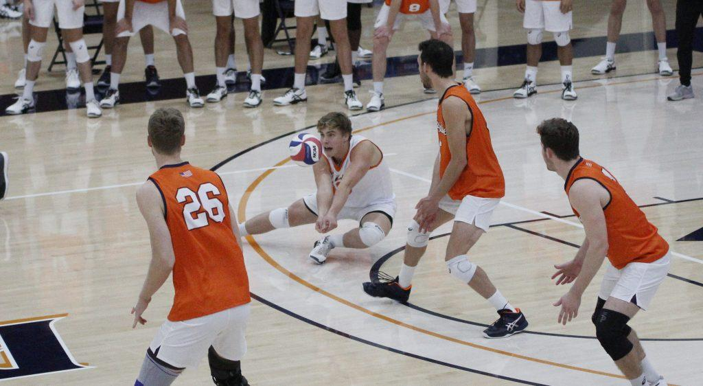 Freshman libero Trey Cole digs a ball during the second set against the BYU Cougars on Saturday at Firestone Fieldhouse. Cole earned the starting position for Saturday's match to boost the Waves' serve receive.