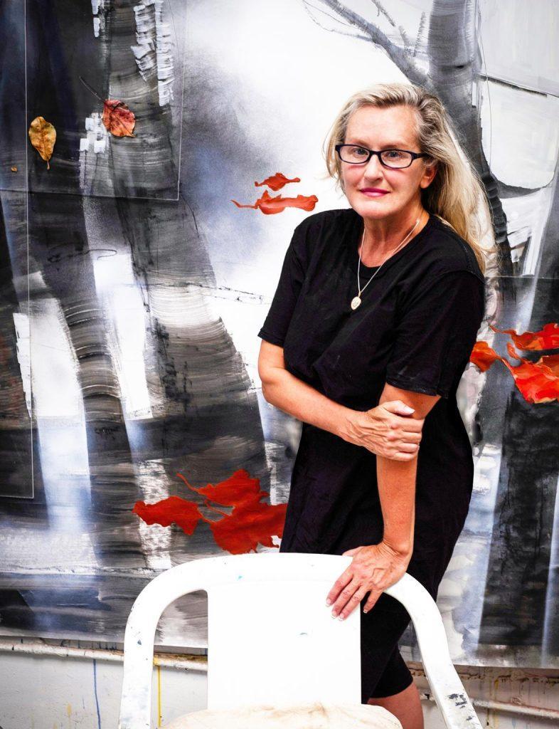 Yvette Gellis poses in front of her abstract art piece. Gellis has been an adjunct professor in the Art Department at Pepperdine since 2014. Photo Courtesy of yvettegellis.com