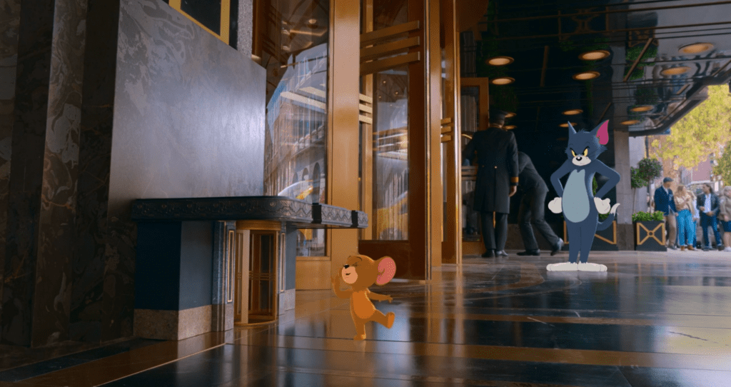 Tom watches as Jerry exits the Royal Gate hotel through his own personal revolving door. This was one of the few scenes in the movie that showcased their traditional dynamic from the cartoon.
