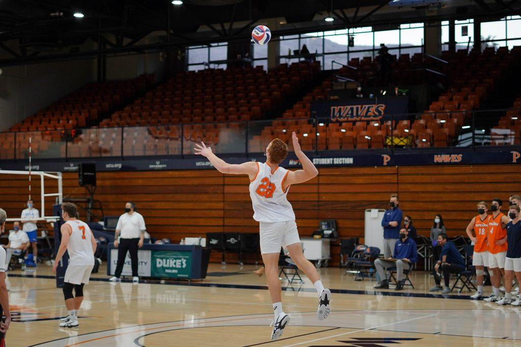 Freshman middle blocker Andersen Fuller bows back for a jump serve against the Bruins. The Waves got revenge on the Bruins after losing in five in LA by winning at home in four sets.