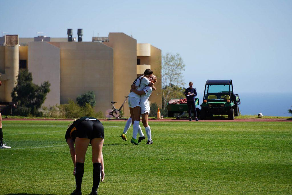 Senior forward Joelle Anderson (left) is lifted by a teammate after scoring in the 69th minute against San Francisco. The senior's goal was the 22nd of her career.