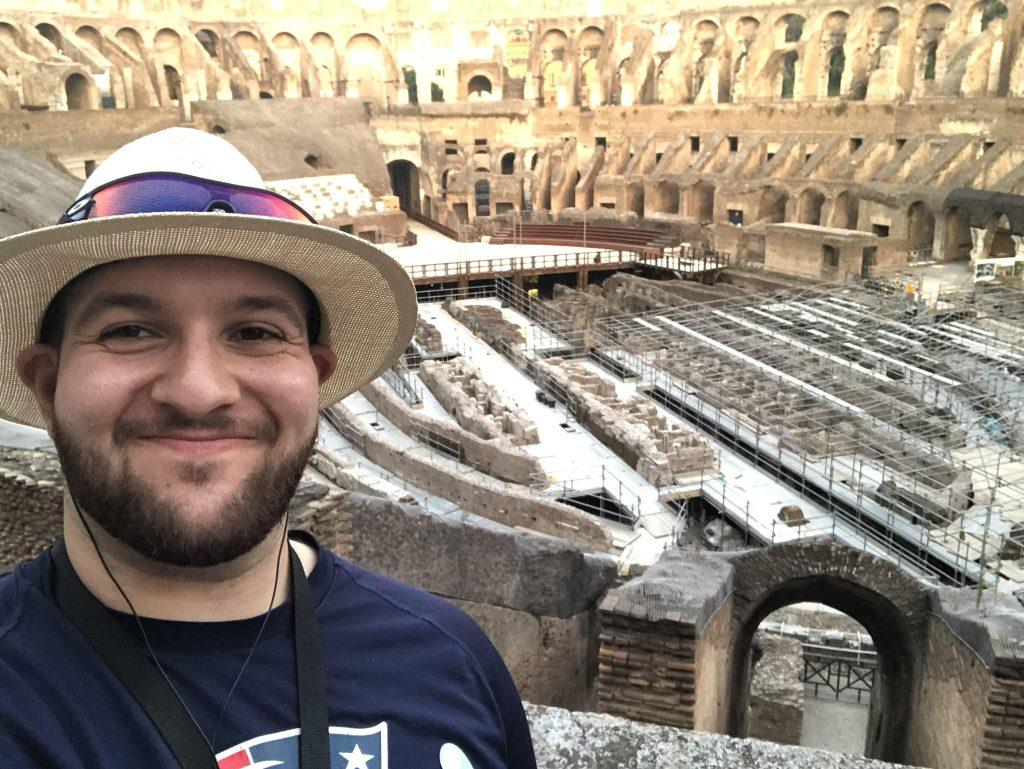Piccuito smiles while wearing a New England Patriots shirt inside the Colosseum in Rome, Italy while on vacation in 2019. Piccuito said he is a lifelong fan of the Patriots, and football is his favorite sport.