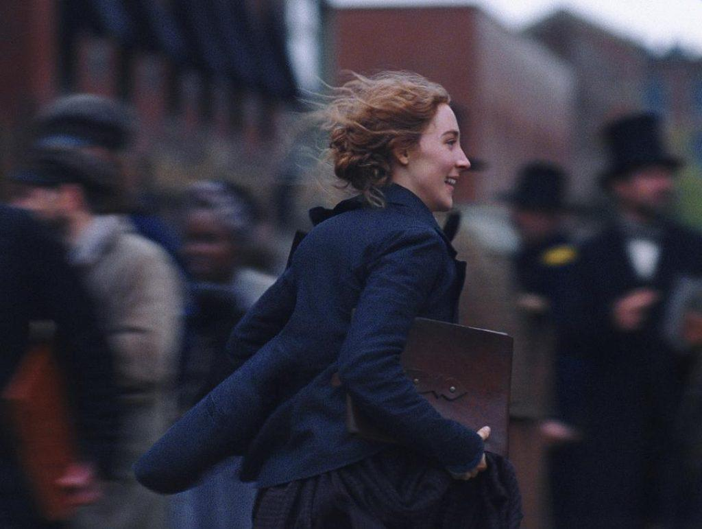 "Jo runs along the street excitedly after publishing her work. Ronan also appeared in Greta Gerwig&squot;s directorial debut of ""Lady Bird."""