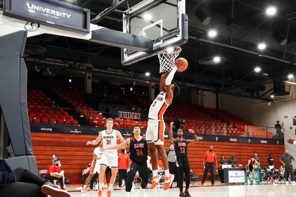 Sophomore guard Sedrick Altman converts a transition layup in the first half versus LMU. Altman contributed to the Waves' 74 points with 10 points, 3 rebounds and 2 assists.