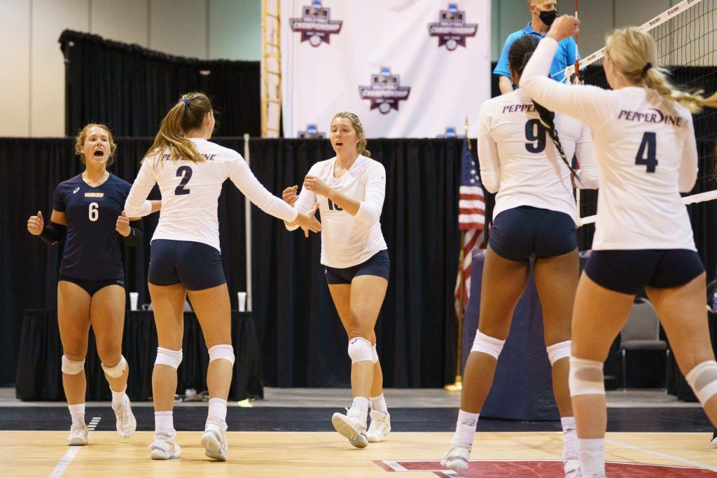 The Waves celebrate a point during their first-round victory against UMBC at the NCAA Tournament. The Waves dominated the first set of the match 25-7 and went on to take the final two sets 25-22 and 26-24.