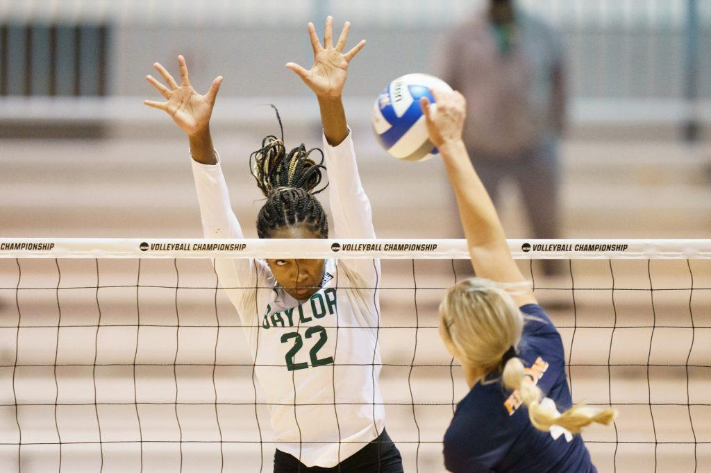 Pepperdine sophomore outside hitter Kayleigh Hames directs a hit against the block of Baylor's Yossiana Pressley in the second round of the NCAA Tournament on April 15 in Omaha, Neb., Hames finished with 7 kills and 5 digs in the match.