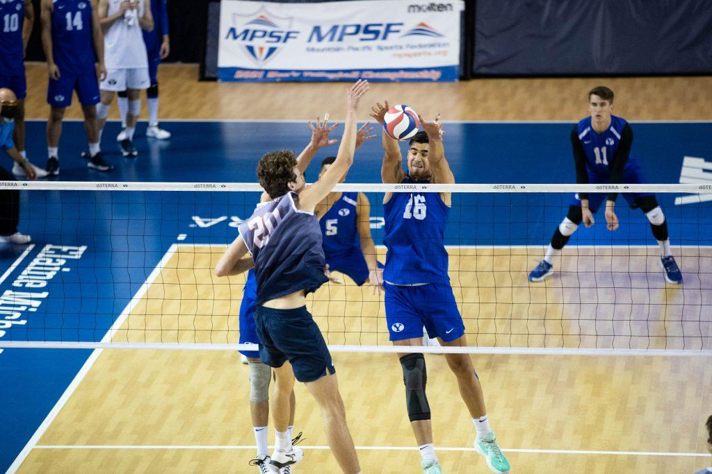 Pepperdine redshirt senior middle blocker Austin Wilmot swings against a block attempt from BYU senior middle blocker Felipe De Brito Ferreira in the championship match of the MPSF tournament April 24. The MPSF named Wilmot to its all-conference second team prior to the tournament.
