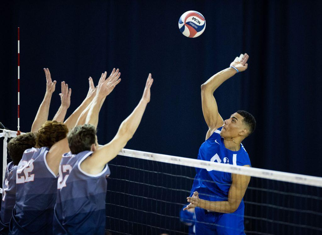 BYU junior opposite Gabi Garcia Fernandez unleashes a swing against a Pepperdine triple block of Spencer Wickens, Andersen Fuller and Jacob Steele on April 24, at BYU. Garcia Fernandez finished with 10 kills in the match, while the Waves registered one block.