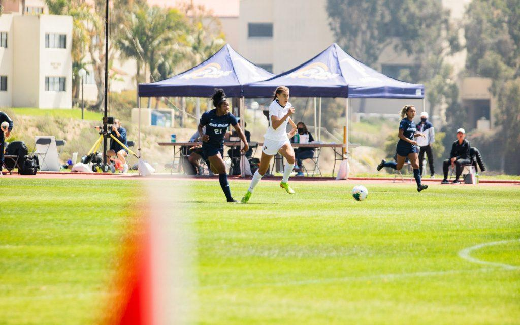 Anderson flies past San Diego sophomore defender Sydney Hopkins during the first half Saturday in Malibu. Anderson scored her second goal of the match on the play.