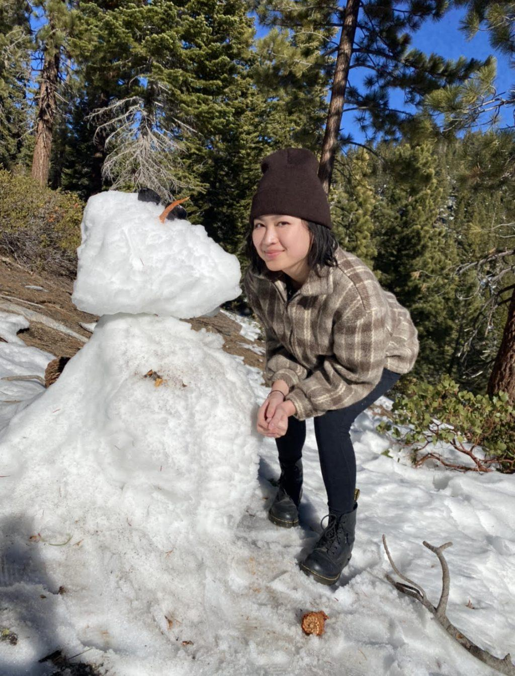 Chan poses with a snowman she found while hiking in Lake Tahoe, Calif., in January. Chan said she wanted to make the move from Northern California to Southern California for a chance to enjoy warmer weather.