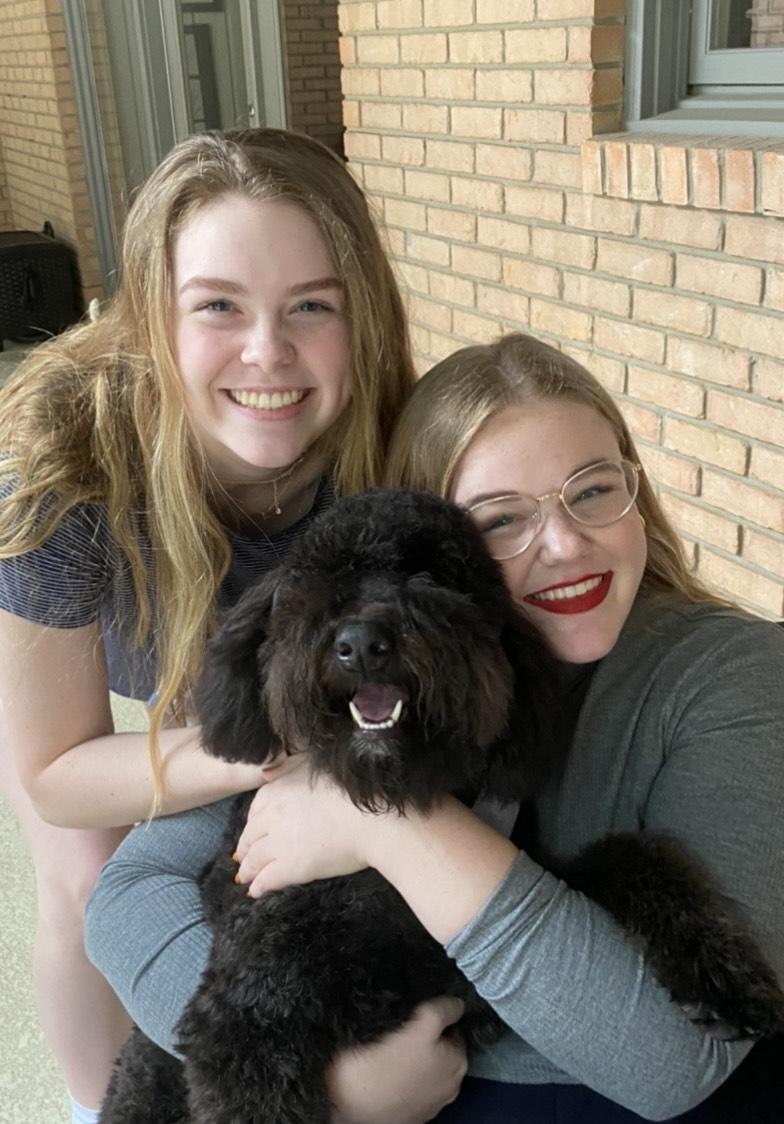 Duvall and her sister Madeline pose with their dog Ripley in Texas, in May. Duvall said she lives with her sister in a Drescher apartment.