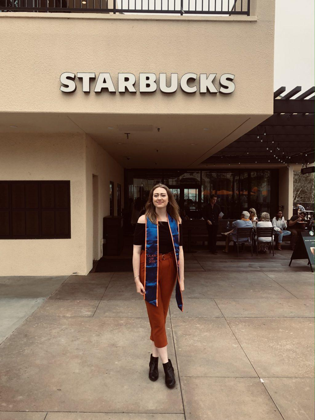Donlon smiles outside of the Malibu campus Starbucks at the end of her final semester at Pepperdine in spring 2019. Donlon said she thinks it is funny that so much of her life involves coffee, between her work with Coffee Monday and her job as a Starbucks barista.