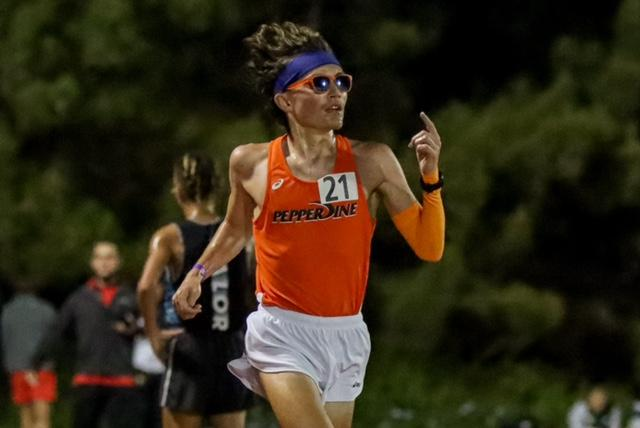Junior Kyle McCabe, a Pepperdine Graphic Assistant News Editor, keeps his 73-second per-lap pace in the 10,000-meter April 17. McCabe shattered the school record by over 27 seconds in his first time in the race.