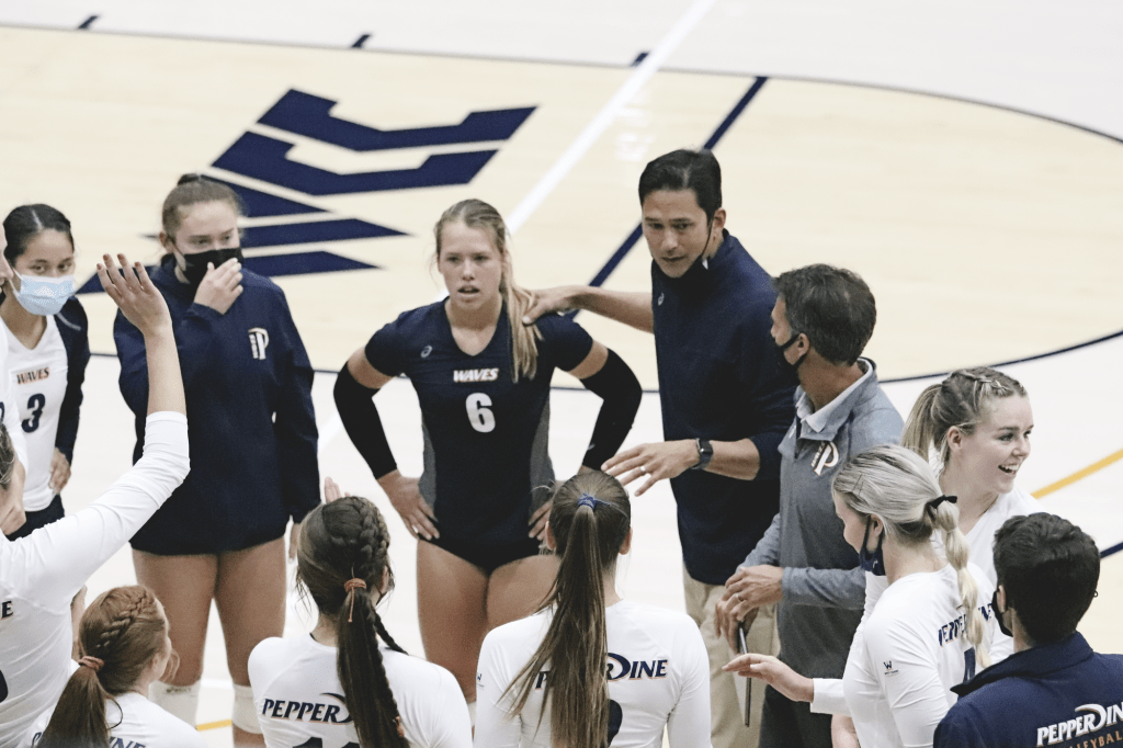 Head Coach Scott Wong speaks to his team during a match Feb. 23, against BYU. In his sixth season at the helm, Wong led the Waves to their second NCAA Tournament appearance in three seasons.