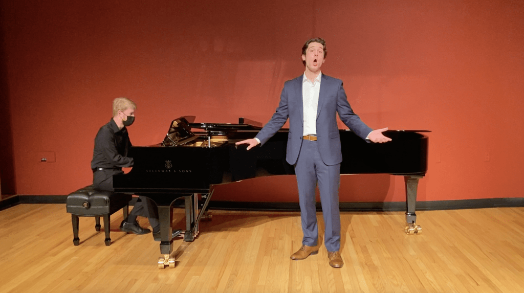 "Senior Music major Joe Hebel belts out a note while singing ""She Cries"" in Raitt Recital Hall on March 9. Hebel said the performances were filmed with a tripod, ring light and the recital hall&squot;s audio equipment. Photo Courtesy of Sydney DeMaria"