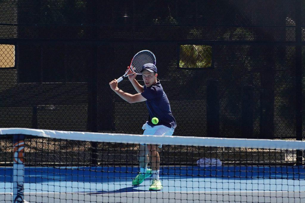 Junior Tim Zeitvogel returns the ball April 11, at Pepperdine. Zeitvogel has battled back from COVID-19 and is returning to top form.