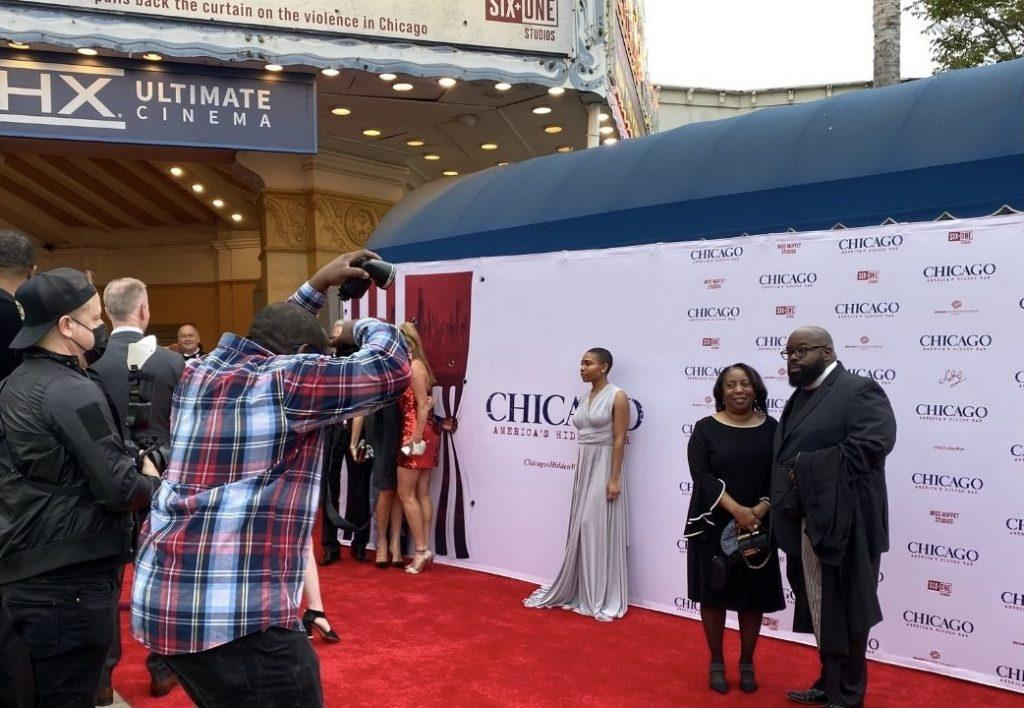 Photographers snap photos of Donovan Price, a respected speaker in Chicago, and his family while on the red carpet at the documentary's premiere in Westwood, Calif. on May 6. Price was a trusted voice for victims, families and Chicago neighborhoods in crisis due to violence. Photo by Beth Gonzales