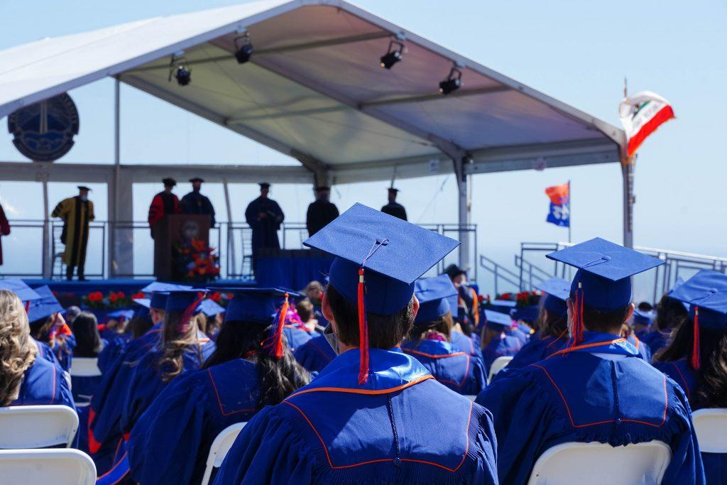 Class of 2020 graduates sit socially distanced on Alumni Park. Pepperdine hosted back-to-back commencements the weekend of May 21-22.