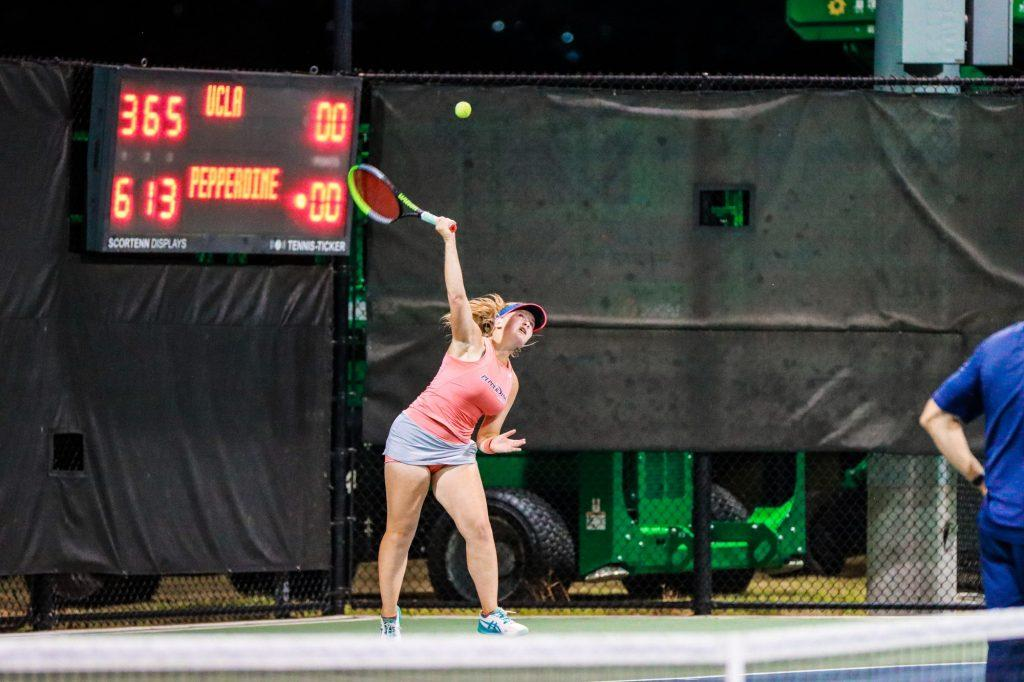 Pepperdine freshman Taisiya Pachkaleva serves against UCLA junior Elysia Bolton during their singles match on court three. Pachkaleva won the match 6-3, 1-6, 7-5. Photo Courtesy of Morgan Davenport | Pepperdine Athletics
