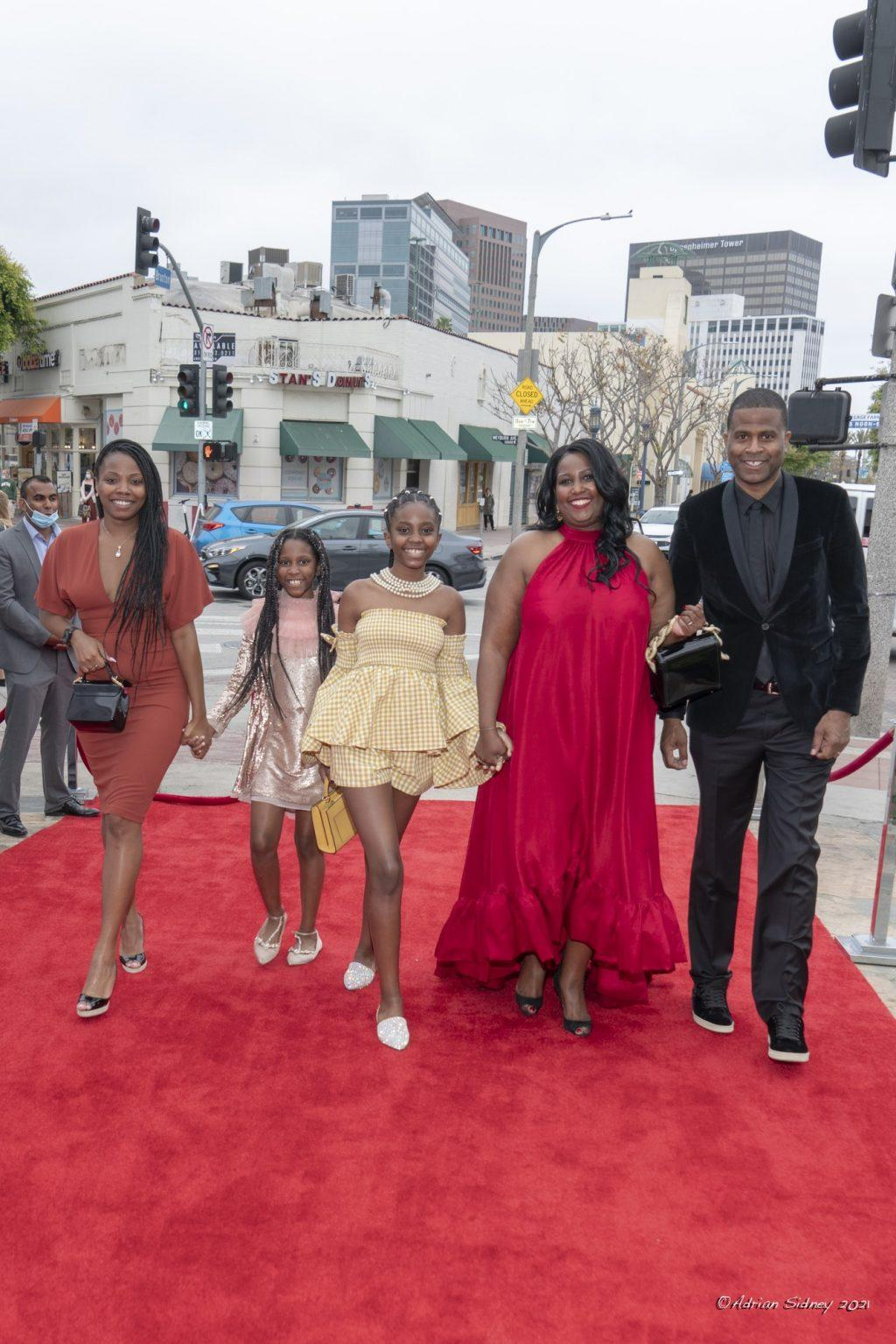 Director Daylight Supreme smiles with his family and producer Tiffany Salaberrios as they walk the red carpet before the film starts. His kids were in the film as the documentary added personal touches to the New York native's life. Photo by Adrian Sidney