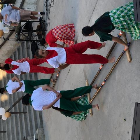 Riley (in red) performs tinikling, a traditional Philippine folk dance, with other members of the Pilipino American Student Association on Heritage Night in the amphitheater on campus in October 2019. Riley said her overall Pepperdine experience has been enjoyable.